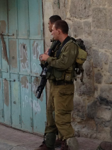 Soldiers Patrolling the Old City of Hebron Photo Credit: Dawn